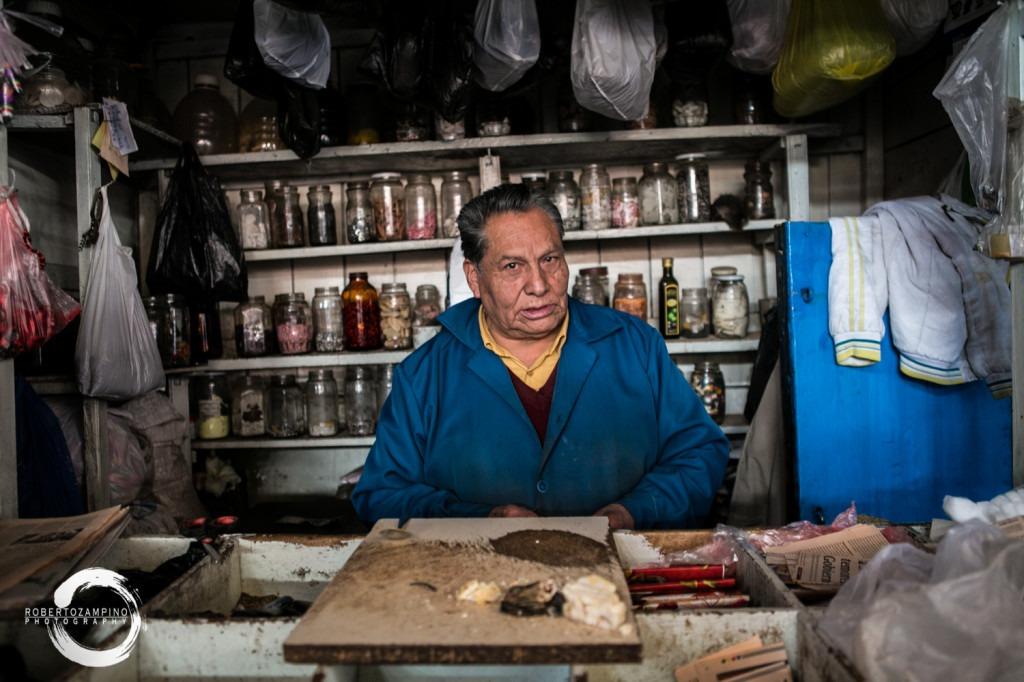portrait - seller from san pedro market cuzco - peru - stall