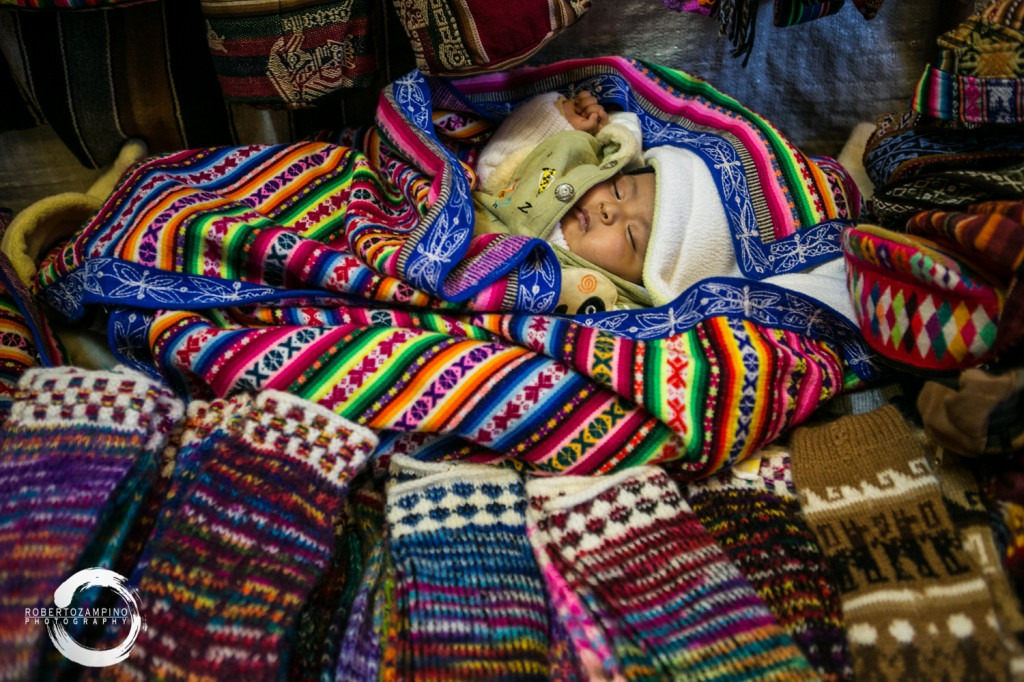 do you sell him? colorful textile wrapped children - cuzco peru