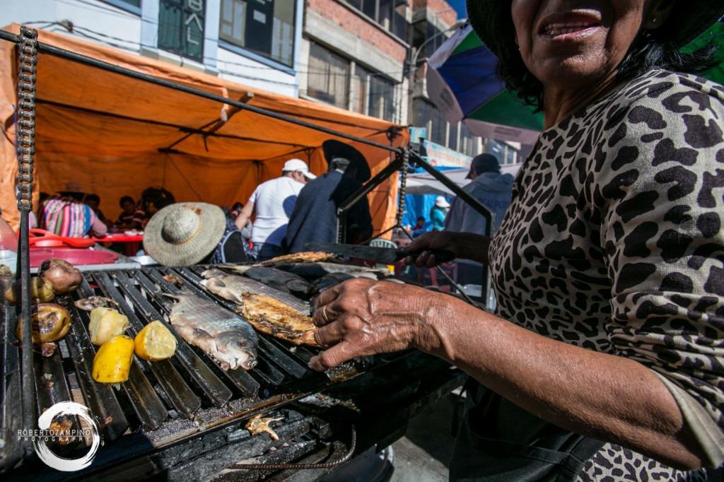 "sunday market in potosi - grilling ""trucia"" lake titikaka trout - bolivia"